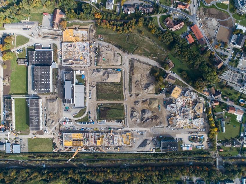 Site du Marly Innovation Center. Groupe E contribue activement à l'assainissement de l'ancien site industrielle. L'énergéticien apporte notamment son expérience en matière d'efficience énergétique, de Facility Management ou d'ingénierie.